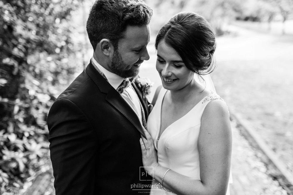 bride and groom smiling near bryngarw house hotel