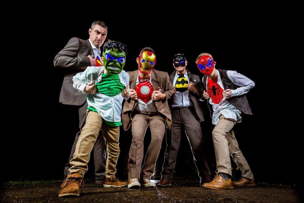 groomsmen wearing superhero masks and tshirts
