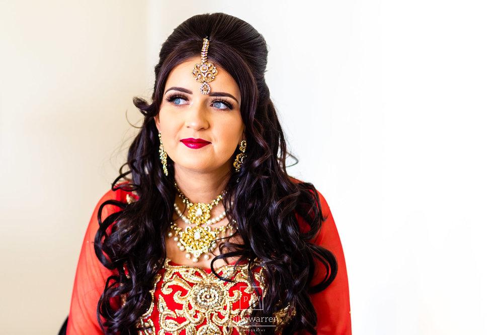bride in red wedding dress before wedding