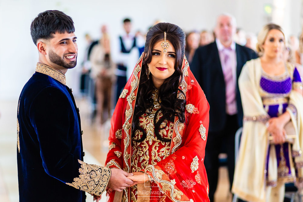 bride and groom smiling in wedding ceremony
