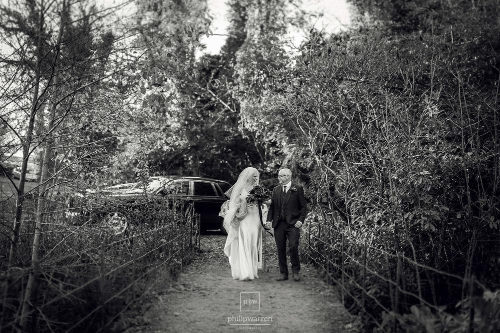 bride walking across bride before the church wedding