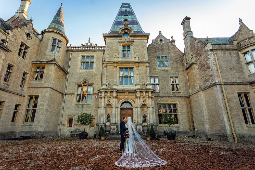 bride and groom outside orchardleigh estate house