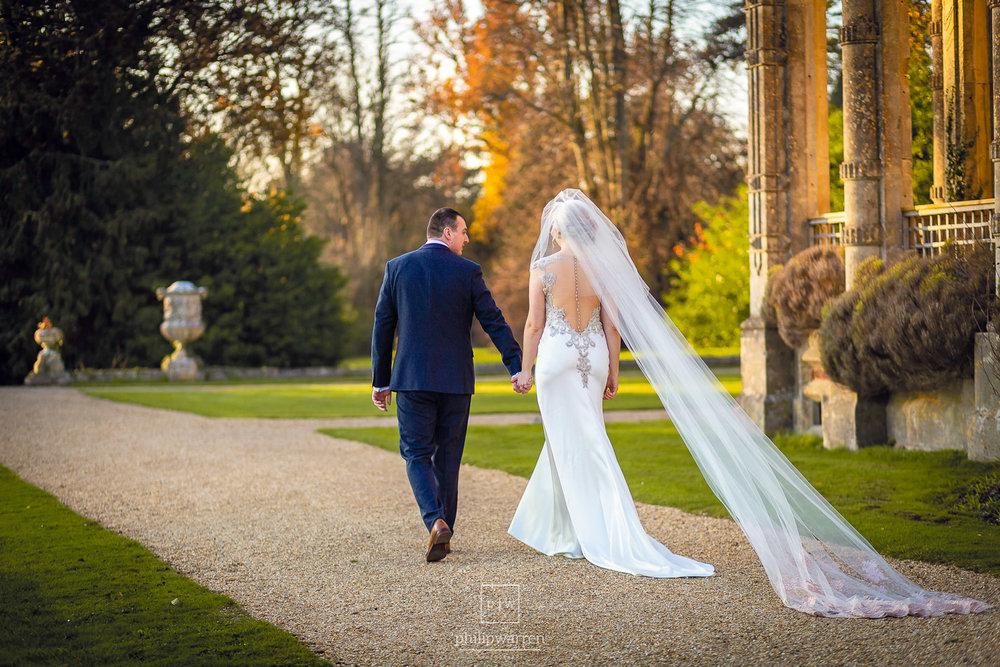 bride and groom walkign holding hands