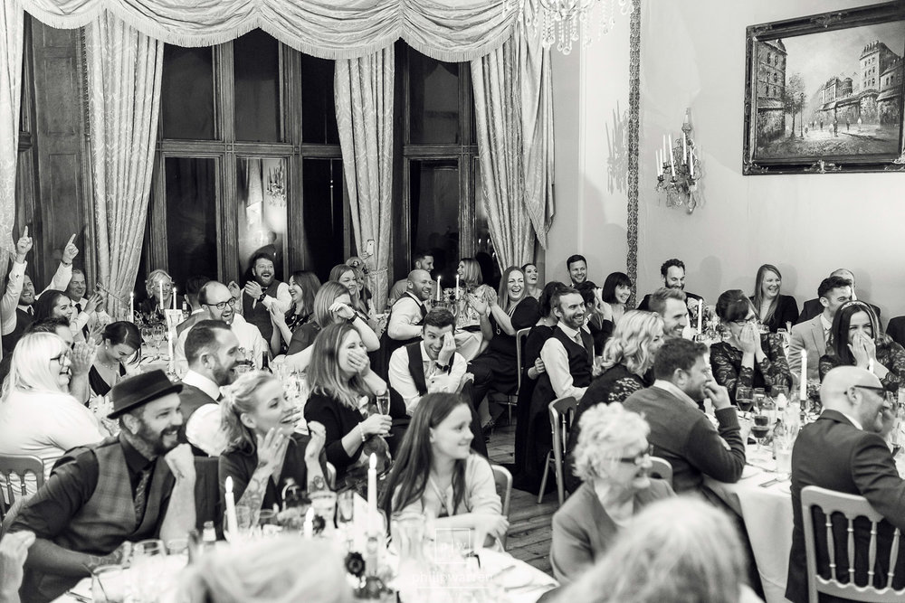 guests laughing at speeches in orchardleigh estate wedding