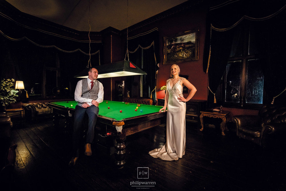 bride and groom wedding photos by snooker table