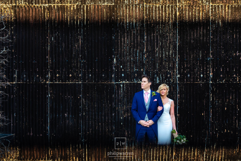 bride and groom wedidng photos in front of a shed