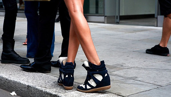Gams for days, owning the sneaker wedge