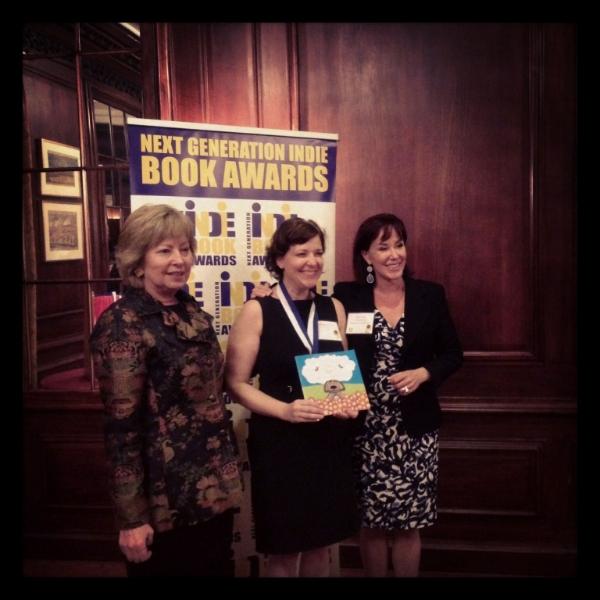 Corine receiving her award.