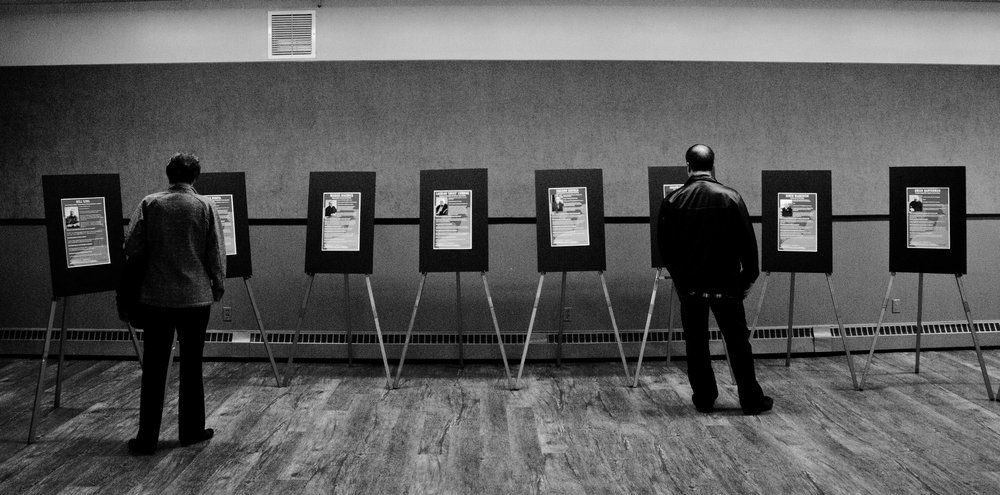For the council race, a large event was held for residents to come out and meet candidates one-on-one. Here, two people read down council candidate profiles, mounted in the Wildrose Pavilion at the Lloydminster Exhibition Grounds.
