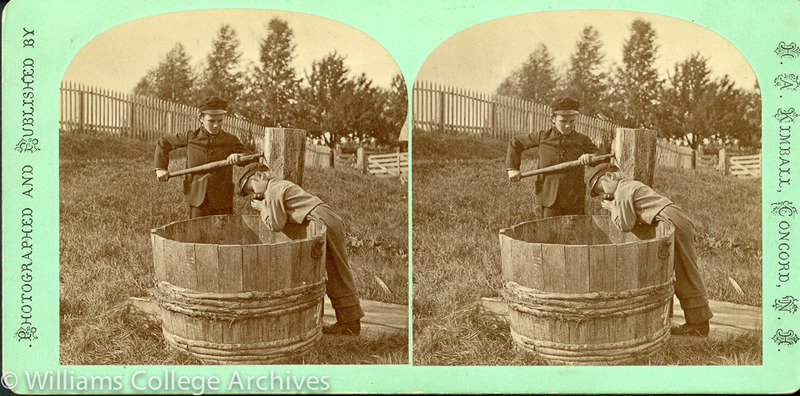 Two Shaker boys drawing water from a well