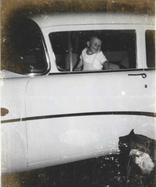 Born to drive: the author poses with his first Buick, won when his ticket was drawn at a metro-Detroit raffle.  (Also pictured: the author's dog, Rocky.)