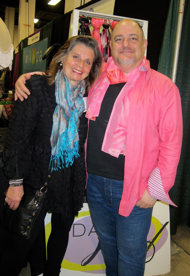 Pam in the DJPK Black Ribbon Jacket, David wearing one of their scarves