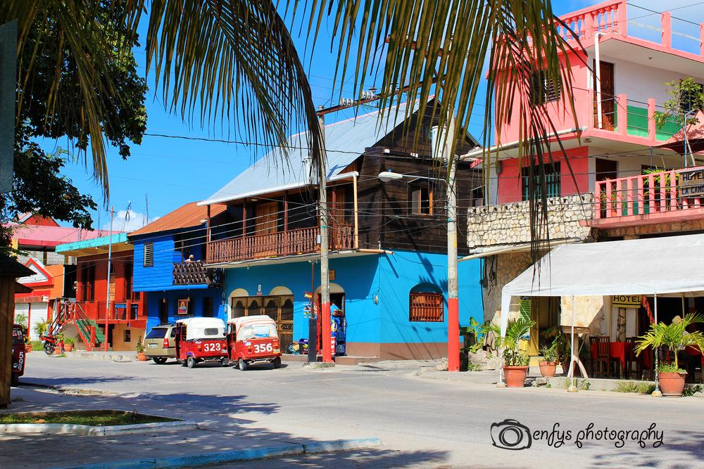 Shops and tuk-tuks -Flores, Guatemala