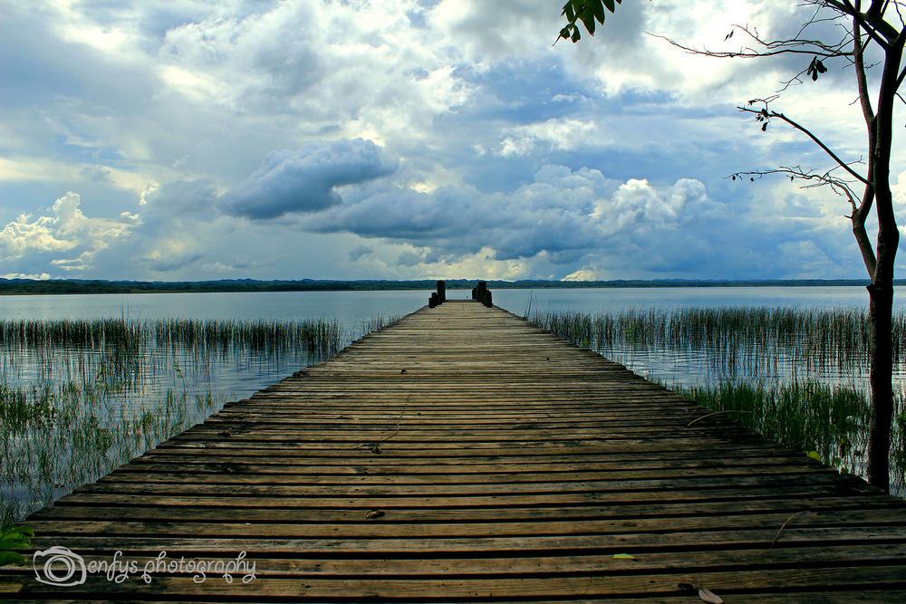 The only dock in town that wasn't submerged. -El Remate, Guatemala