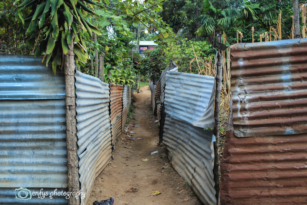 Side streets - corrugated metal separating peoples property (Click to enlarge) -San Pedro la Laguna, Guatemala