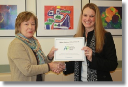 KHS Principal Susan Cressey Receives the AP Honor Roll certificate from College Board Representative Mary Ellen Auriemma.