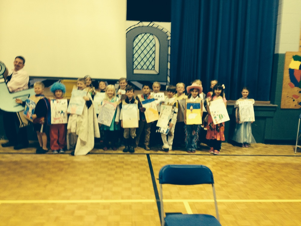 Mr. Nye's second grade class proudly wearing the book jackets they made.