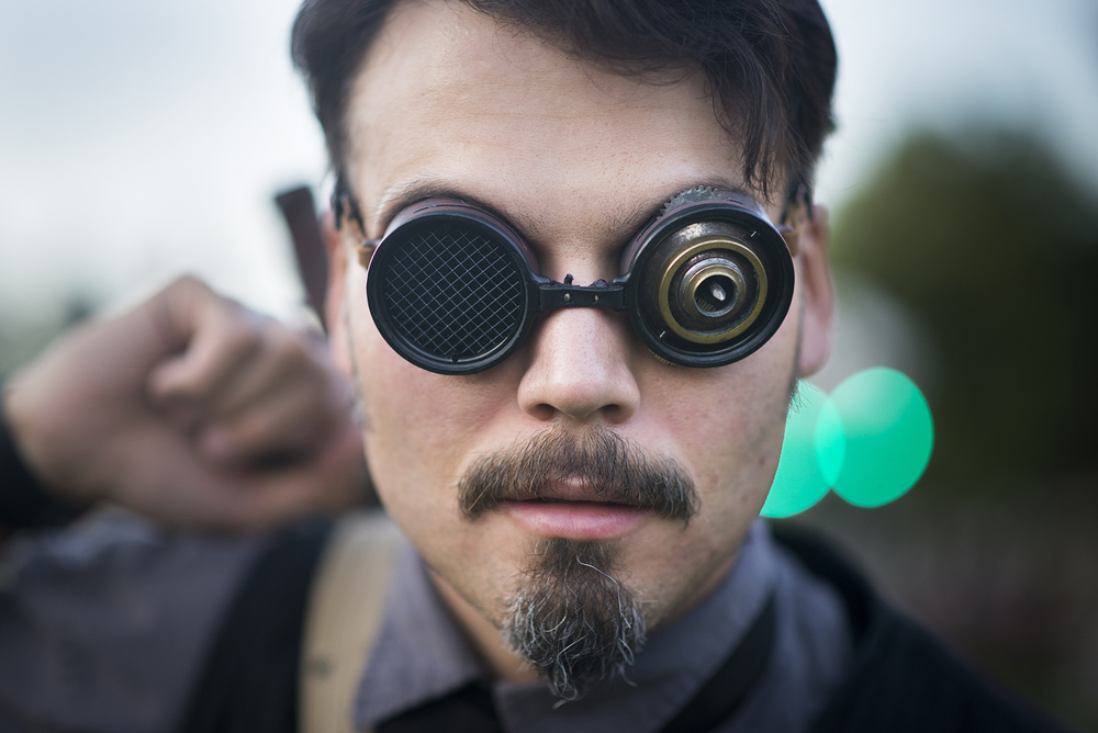 Ryan Spellman, of Airship Athena, poses for a portrait on Friday, August 29, 2014 at Final Fridays on the Square in Nelsonville, Ohio.  Spellman's steampunk style goggles are made to match his lack of vision in his left eye.