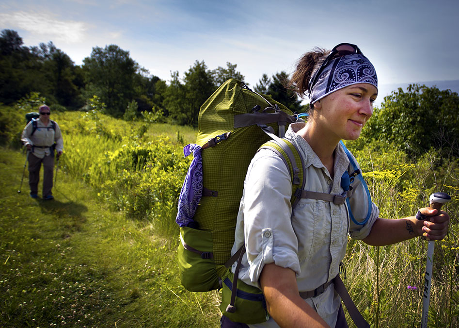 Natalie Koffarnus hikes into a clearing as Jenni Heisz follows on the Ice Age Trail as a part of the Warrior Hike Program on Thursday, July 16, 2015 in West Bend, Wi.