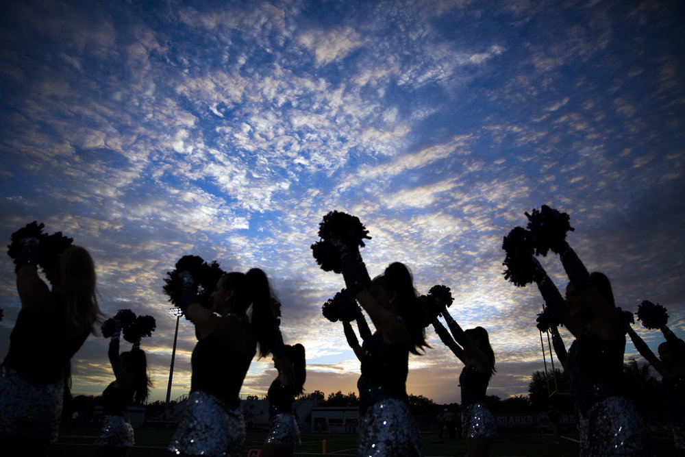 Cheerleaders file onto the field for pregame on Friday, October 28, 2016 at Gulf Coast High School in Golden Gate.