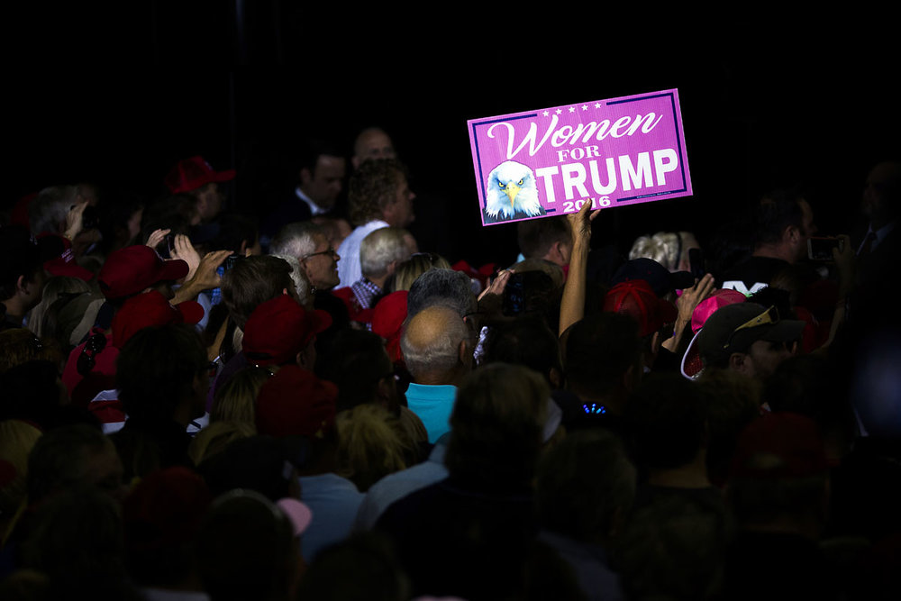 A crowd member holds a women for Trump sign as Republican candidate Donald Trump speaks at Robarts Arena on the Sarasota fair grounds on Monday, November 7, 2016 in Sarasota, Florida.