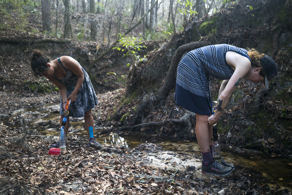 - Cyrilia Trudel-Gazquez and Gretchen Matt simultaneously fill their water bottles with water from a creek near the Suwannee River. Cyrilia, a fellow thru-hiker, began her journey in the Florida Keys and continued hiking north after completing the Florida Trail to the Appalachian Trail and then plans to finish in Canada.
