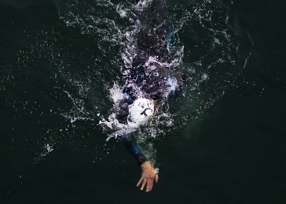 Triathletes swim on the first leg of the race during the Olympic-Distance National Championships on Saturday, August 8, 2015 at the Lakefront in downtown Milwaukee.