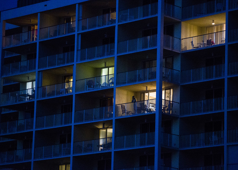 Residents look out from balconies on Friday, October 31, 2016 at South Beach on Marco Island.  Midnight marks the end of turtle nesting season. As it begins to get darker earlier, lights from surrounding condos disorient the hatchlings.