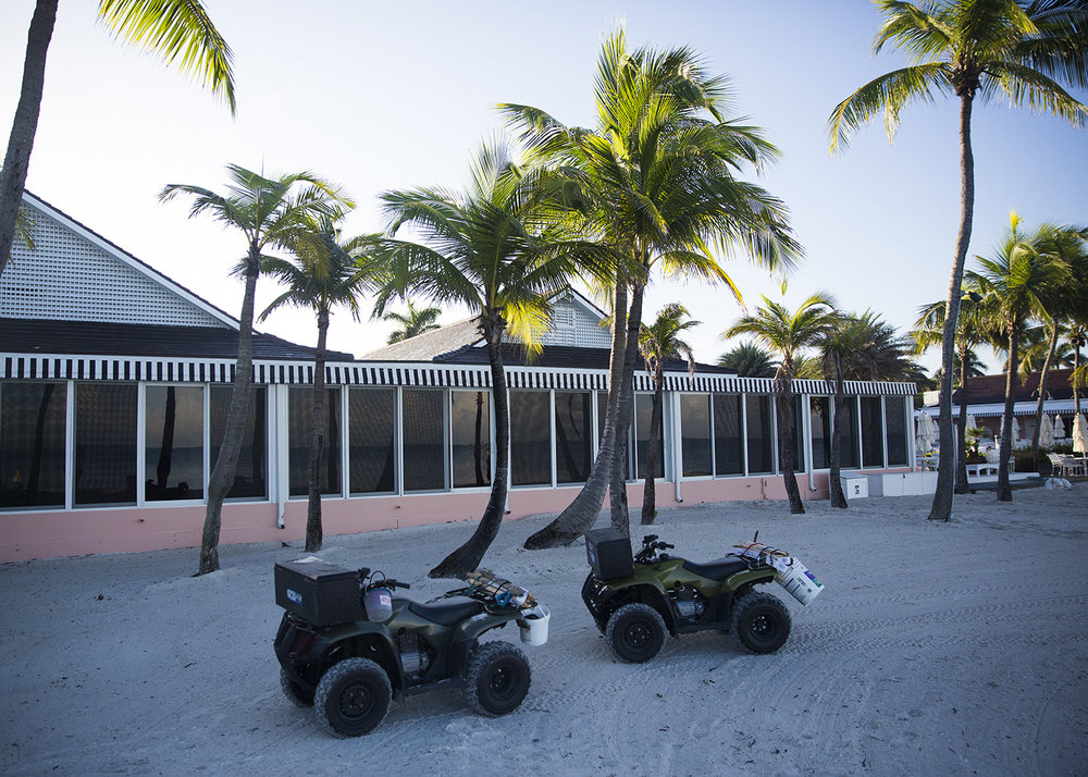 Kraus and Kenton use all terrain vehicles to cover the roughly 5.6 miles of beach in the morning on Saturday, July 15, 2017 along the beach in Downtown Naples.