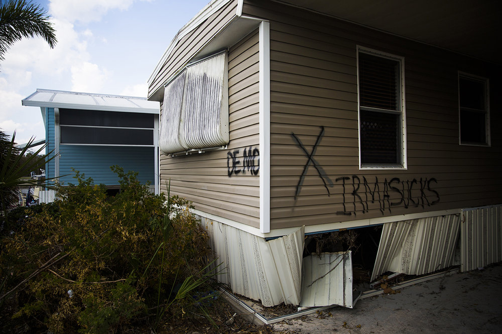 "A few trailer homes are marked with the word ""demo"" in Fisherman's Cove on Thursday, September 21, 2017 in Everglades City."
