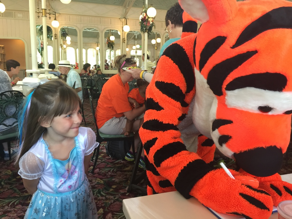 Tigger was fun! He signed Emery's book and made her day! Just look at her face!