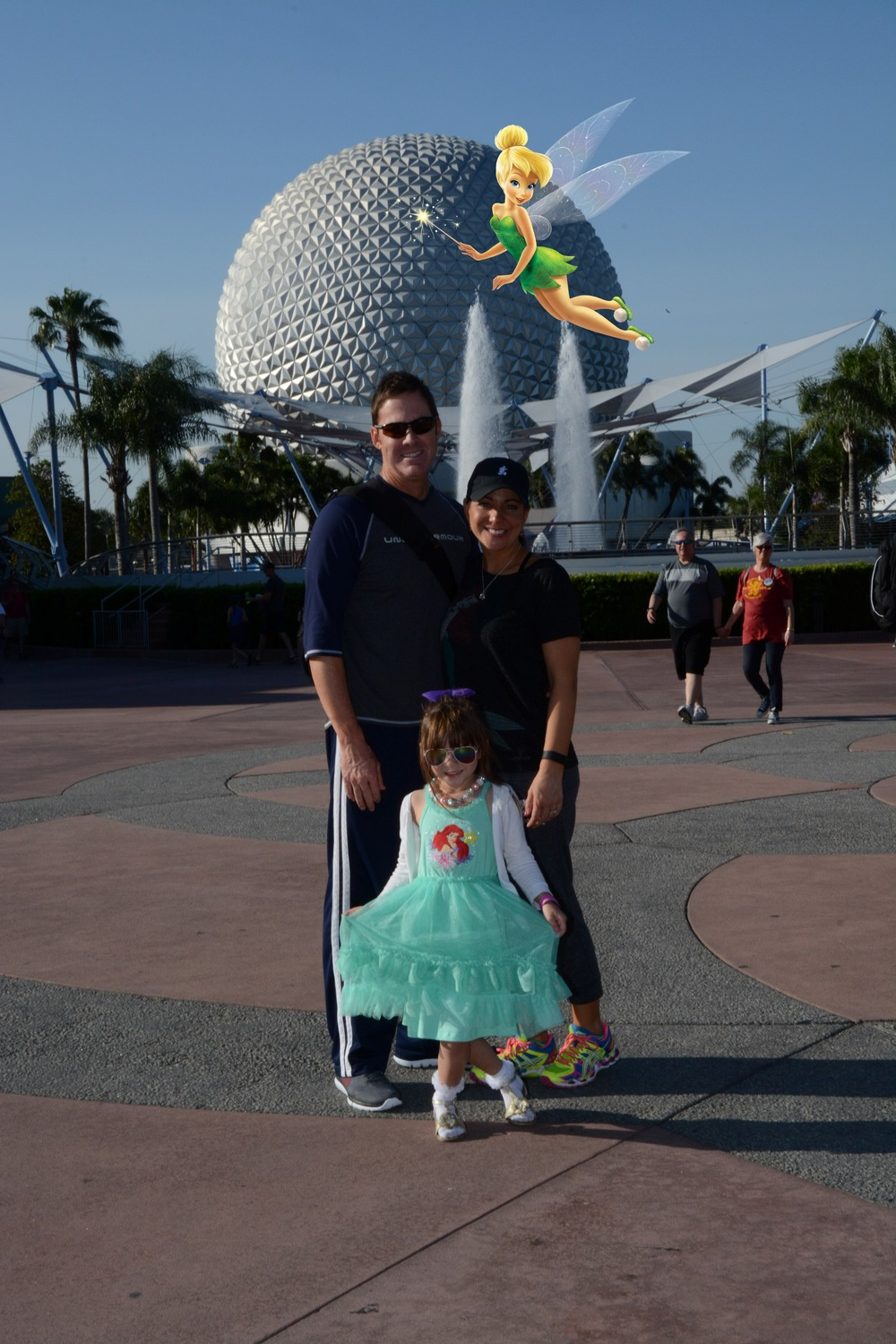 We spent a day in the Park and then a day recovering at our resort. This particular day we were at Epcot - which might be my favorite park! Tink followed us as our magical tour guide the whole way through!