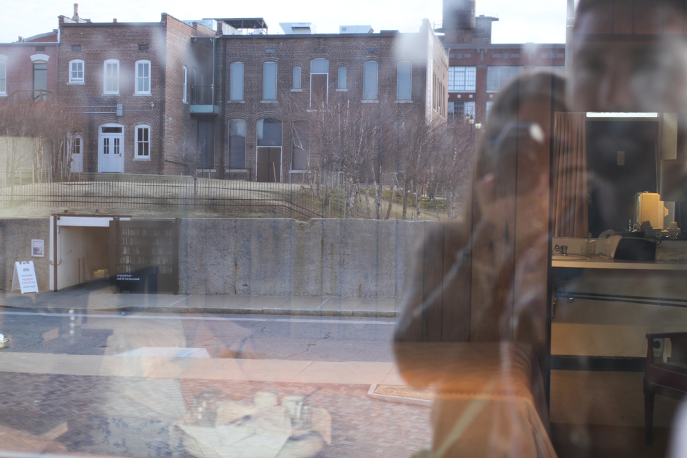 Jared and I looking in on Room 307 at the Lorraine Motel, left untouched after the death of Dr. King. The building in the reflection was the location of the shooter.