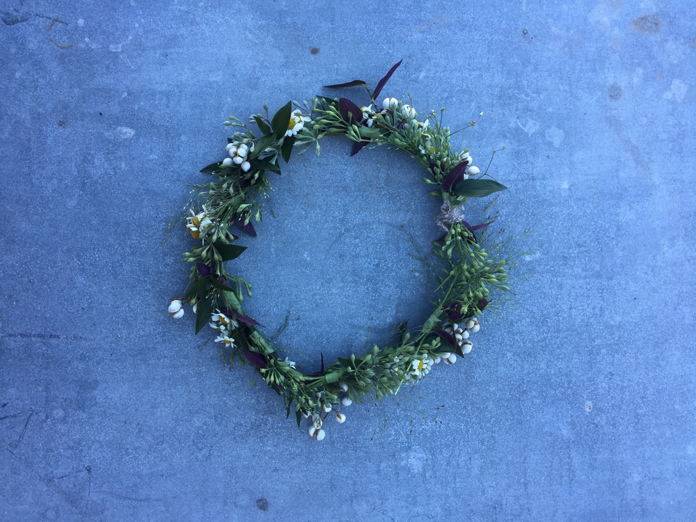 A simple flower crown for the bride made from wildflowers, bridalveil, and chamomile.