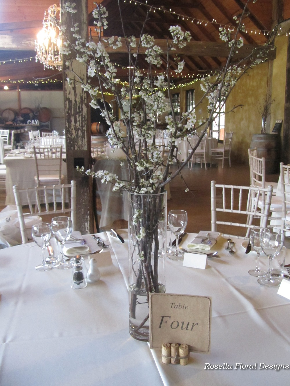 Sticks cherry blossom table centerpiece long vase.jpg