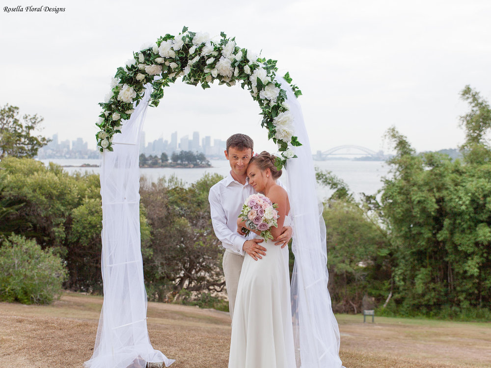 Floral arch for hire $150. Includes set up, silk flowers and tulle Dimensions: Arch Height: 2.25m ; Length: 1.2m; Depth: o.4m