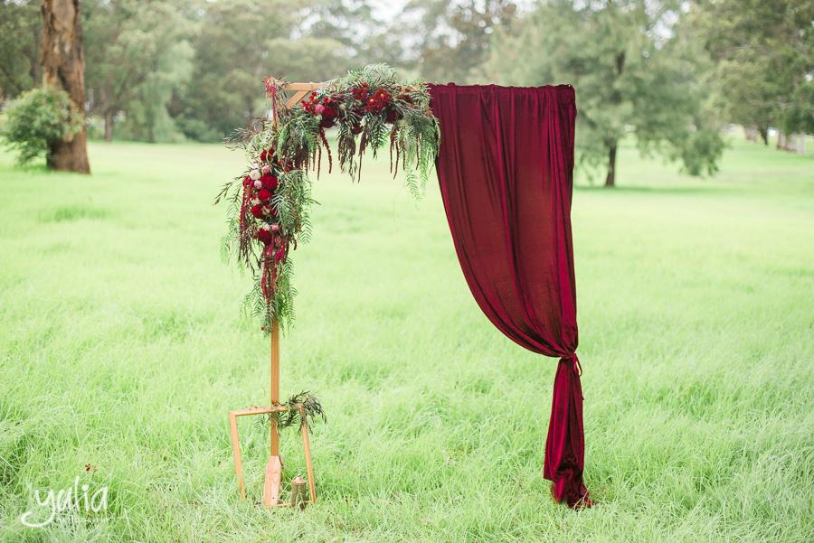 Wooden floral arch burgundy red marsala .jpg