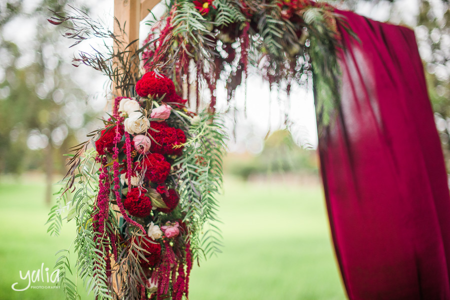 Wooden floral ceremony arch red burgundy marsala.jpg