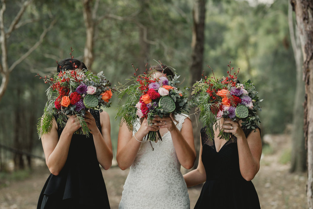 Loose natural bridal bouquet green orange red.jpg