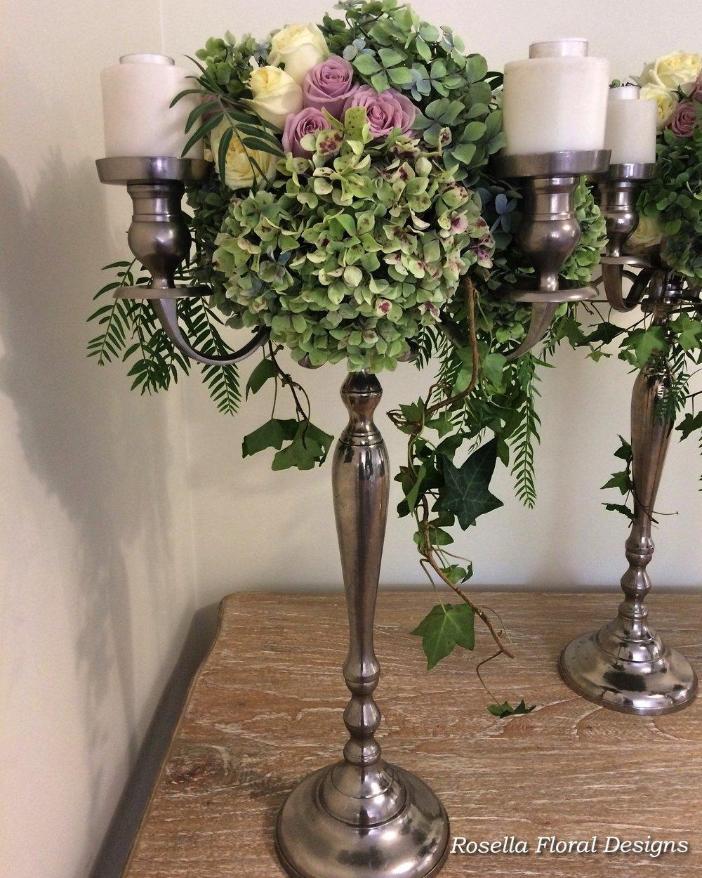 Tall candelabra floral centerpiece.jpg