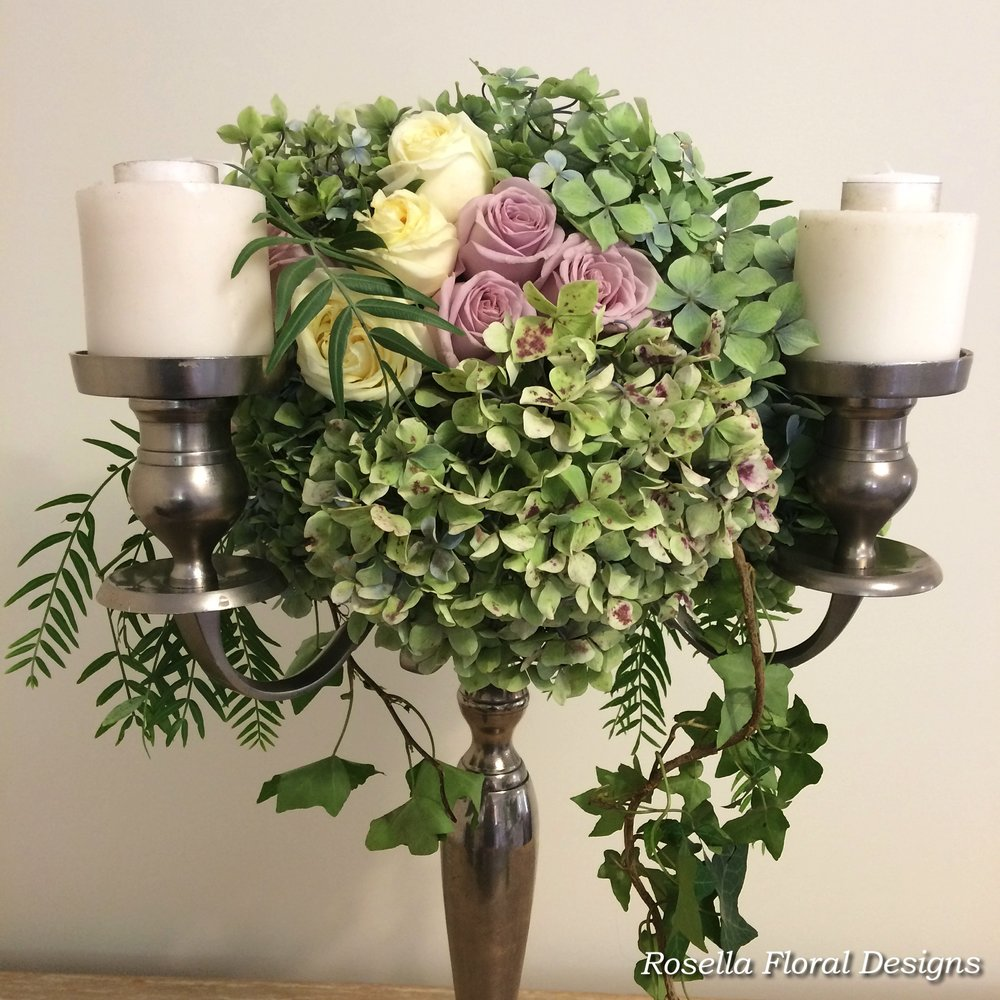 Silver candelabra floral arrangement wedding.jpg