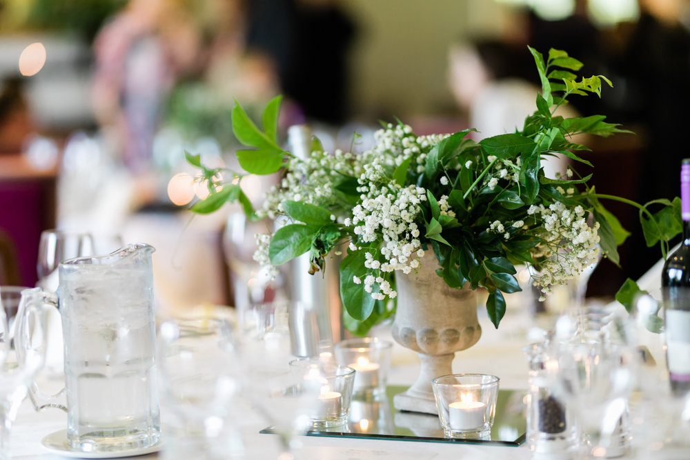 White & green table centerpiece in urn, baby's breath.jpg