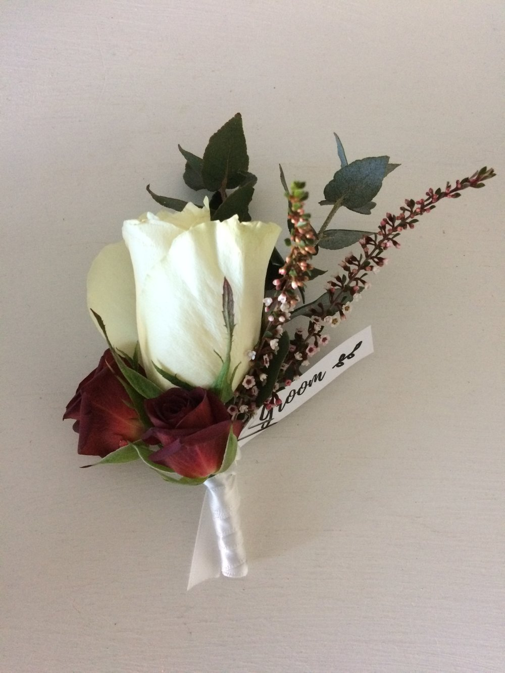 White & red rose buttonhole.JPG