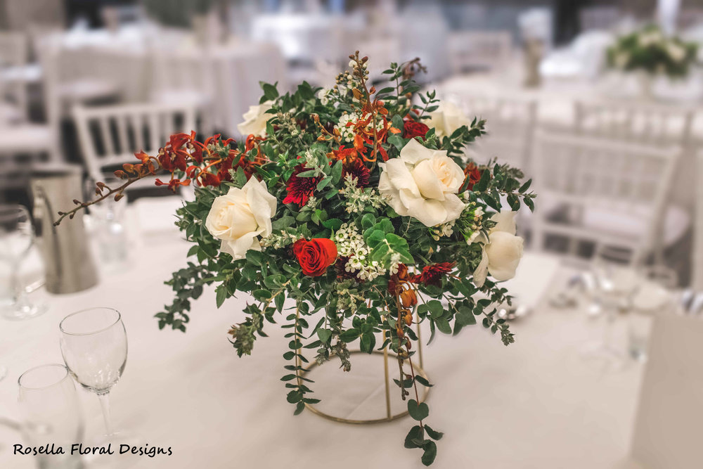white, green, red floral arrangements for wedding.JPG