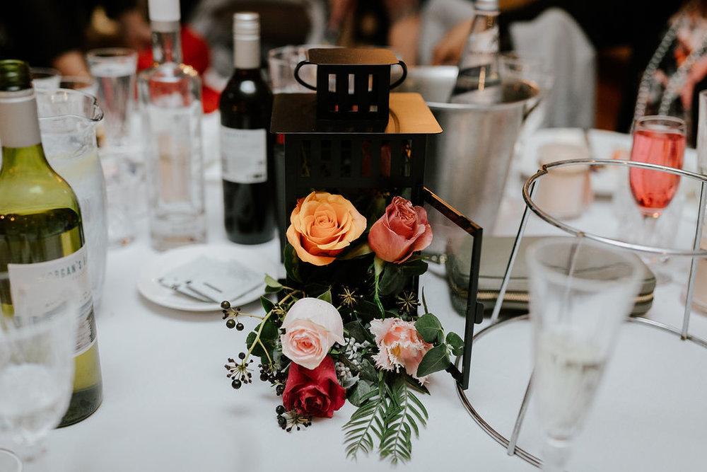 Black lantern with flowers wedding centerpiece.jpg