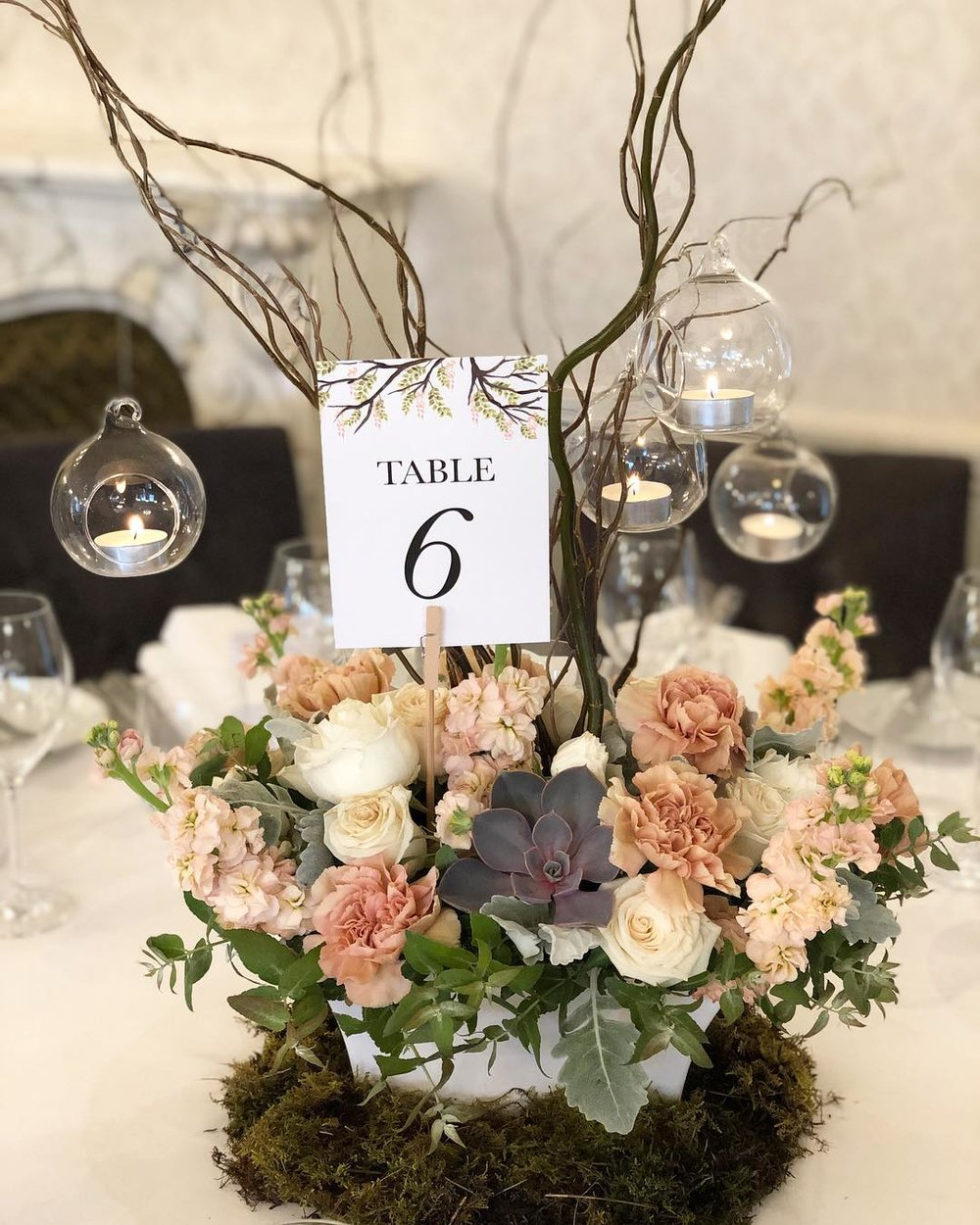 floral centerpiece with sticks.jpg