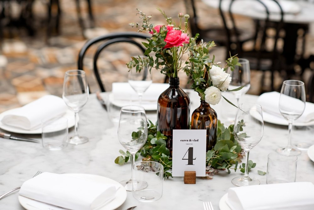 Table centerpieces in brown bottles.jpg