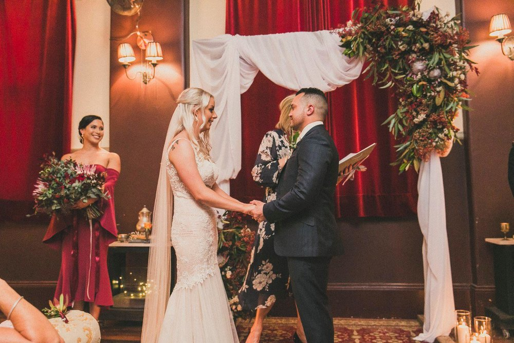 Australian natives burgundy wedding arch flowers.jpg