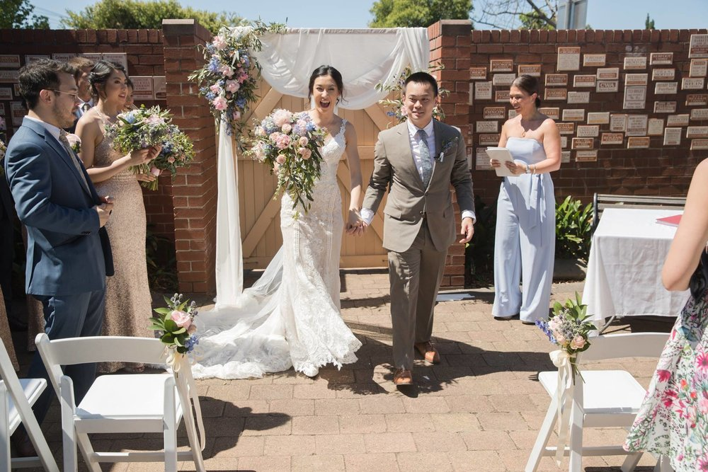 wedding arch with flowers and draping.jpg