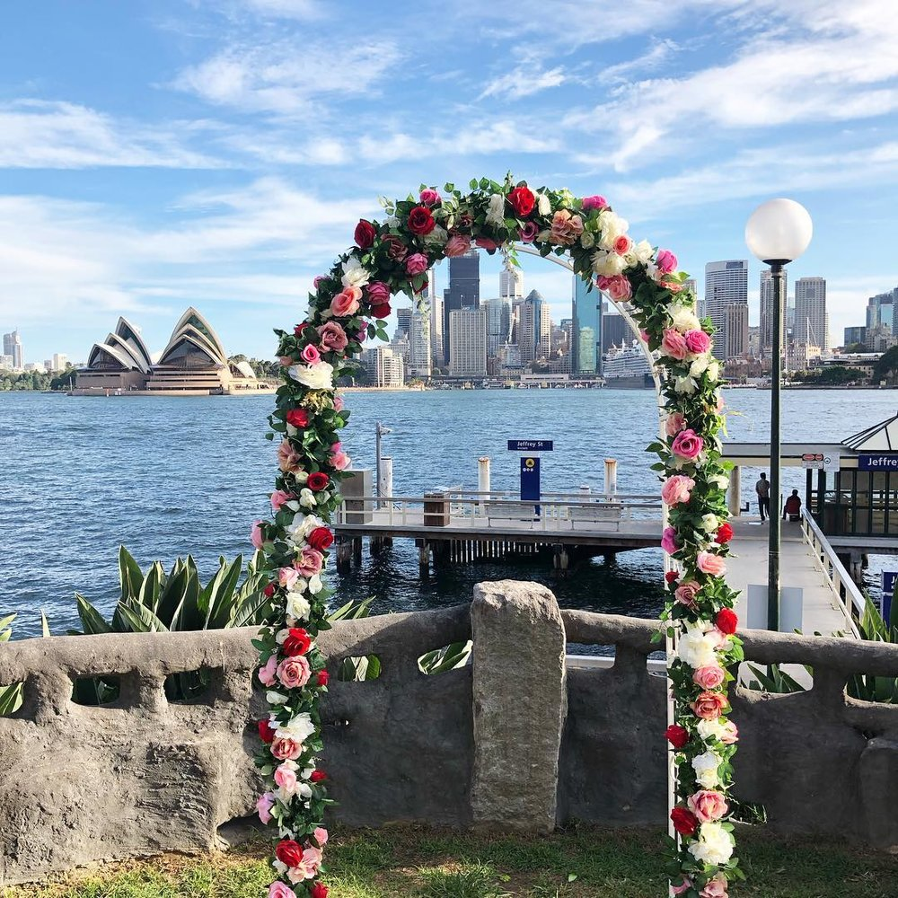 Floral arch for hire $200. Includes set up, silk flowers & silk greenery.  Dimensions: Arch Height: 2.25m ; Length: 1.2m; Depth: o.4m